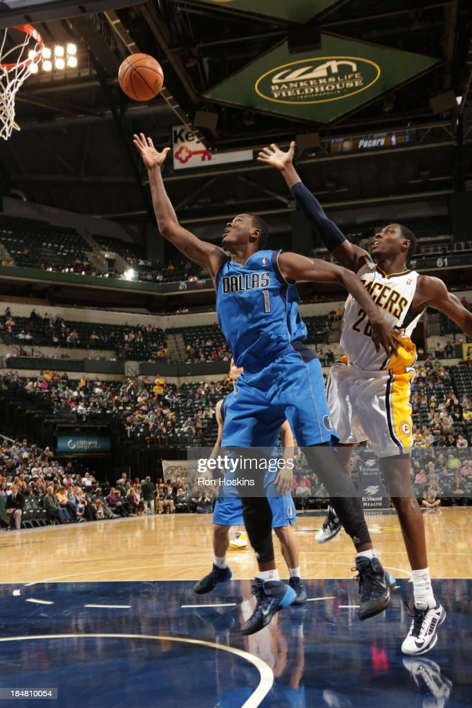 Samuel Dalembert #1 of the Dallas Mavericks shoots against Ian Mahinmi #28 of the Indiana Pacers at Bankers Life Fieldhouse on October 16, 2013 in Indianapolis, Indiana.