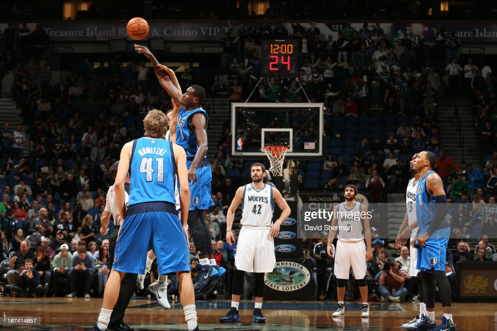 Samuel Dalembert #1 of the Dallas Mavericks wins the opening tipp off against the Minnesota Timberwolves on November 8, 2013 at Target Center in Minneapolis, Minnesota.