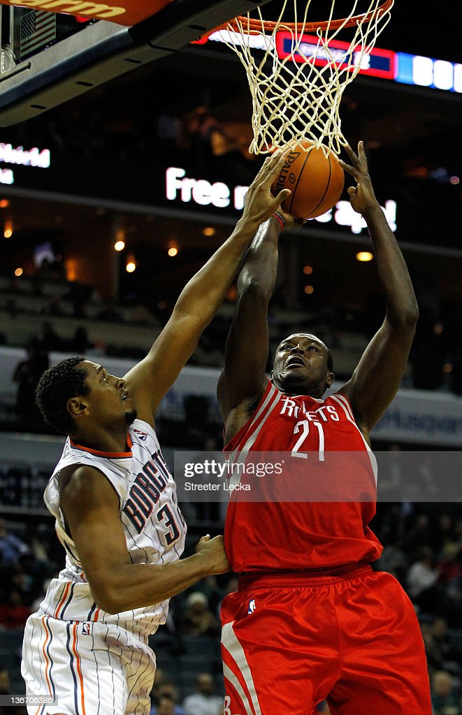Samuel Dalembert #21 of the Houston Rockets goes to the basket over Boris Diaw #32 of the Charlotte Bobcats during their game at Time Warner Cable Arena on January 10, 2012 in Charlotte, North Carolina.