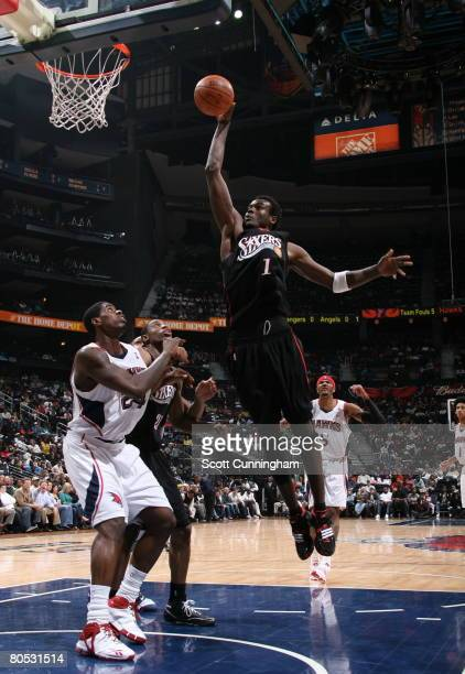 Samuel Dalembert of the Philadelphia 76ers goes up for a shot against Marvin Williams of the Atlanta Hawks at Philips Arena April 4 2008 in Atlanta...