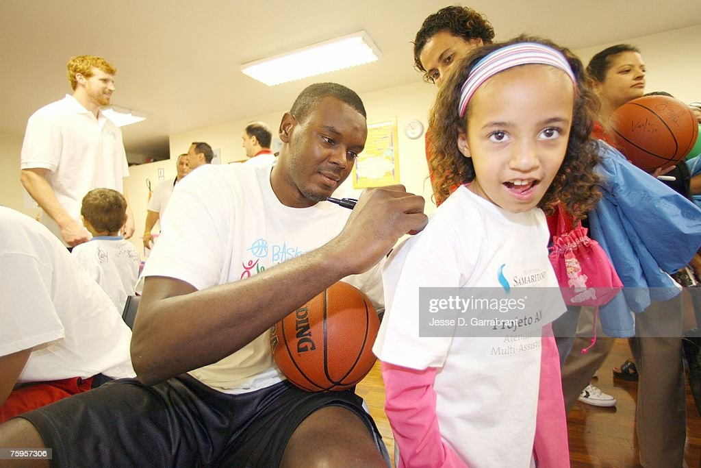 Samuel Dalembert of the Philadelphia 76ers signs an autograph during Basketball Without Borders on August 3, 2007 in Sao Paulo, Brazil.