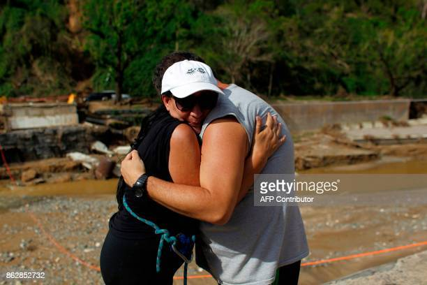 Samuel De Jesus and his aunt Nilda Diaz embrace after not having seen each other before the passage of Hurricane Maria at the Rio Abajo community in...