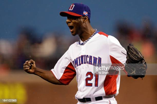 Samuel Deduno of the Dominican Republic reacts after a strike out to end the fifth inning against Puerto Rico during the Championship Round of the...