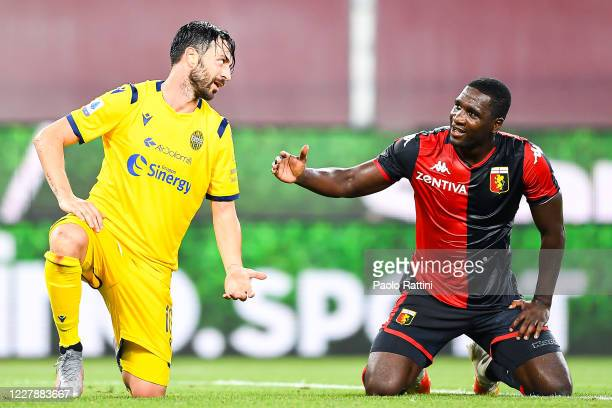 Samuel Di Carmine of Hellas Verona and Cristian Zapata of Genoa chat during the Serie A match between Genoa CFC and Hellas Verona at Stadio Luigi...
