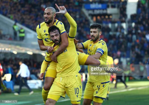Samuel Di Carmine of Hellas Verona celebrates with his teammates Sofyan Amrabat and Miguel Veloso after scoring the opening goal during the Serie A...