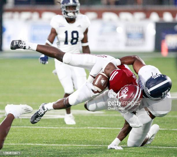 Samuel Emilus of the University of Massachusetts Minutemen is brought down by Quin Williams of the Georgia Southern Eagles in the fourth quarter on...