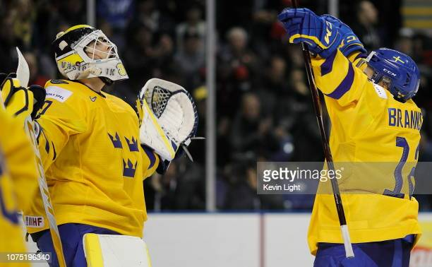 Samuel Ersson and Erik Brannstrom of Sweden celebrate a win over Finland at the IIHF World Junior Championships at the SaveonFoods Memorial Centre on...
