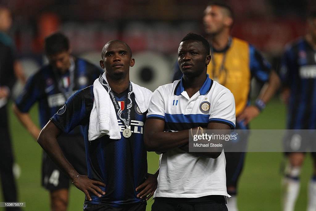 Samuel Eto'o (l) and Sulley Ali Muntary (r) look dejected after Inter's 0-2 defeat during the UEFA Super Cup match between Inter Milan and Atletico Madrid at Louis II Stadium on August 27, 2010 in Monaco, Monaco.