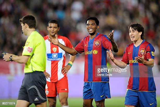 Samuel Eto'o and teammate Bojan Krkic of Barcelona argue with referee Antonio Rubinos Perez during the La Liga match between UD Almeria and Barcelona...
