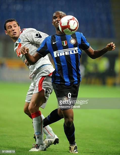 Samuel Eto'o Fils of FC Inter Milan and Mariano Bogliacino of SSC Napoli compete for the ball during the Serie A match between FC Inter Milan and SSC...