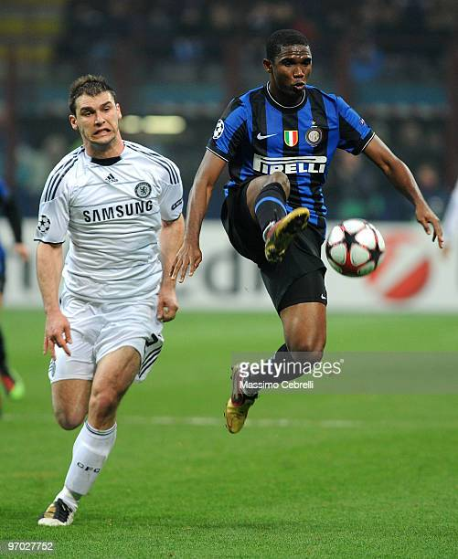 Samuel Eto'o Fils of FC Inter Milan battles for the ball against Branislav Ivanovic of Chelsea during the UEFA Champions League round of 16 first leg...