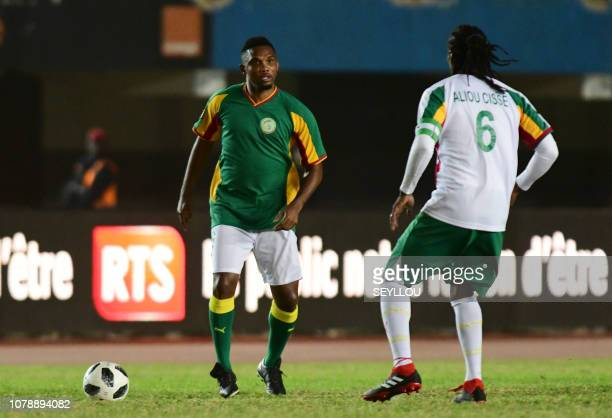 Samuel Eto'o from Team Generation 2002 vies for the ball with Aliou Cisse from Team Legends of the CAF during the match of the Legends in homage of...