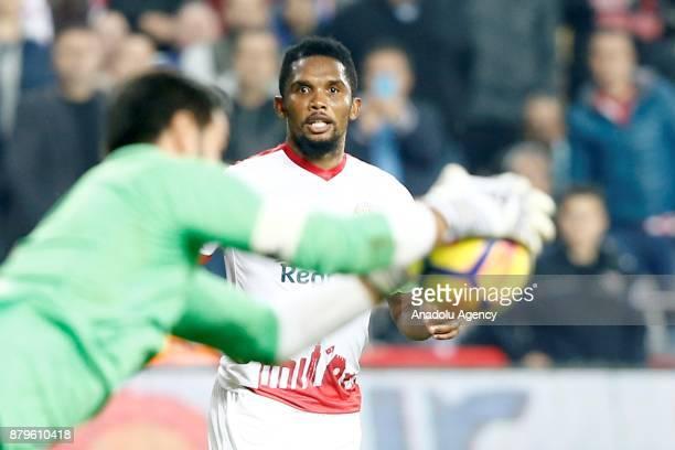 Samuel Eto'o of Antalyaspor and Volkan Demirel of Fenerbahce in action during the Turkish Super Lig match between Antalyaspor and Fenerbahce at...