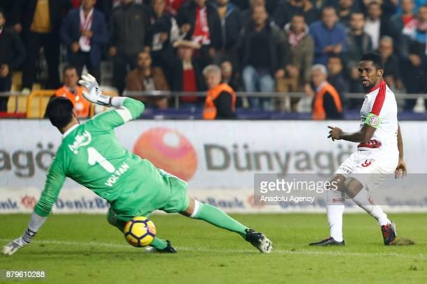 Samuel Eto'o of Antalyaspor in action against Volkan Demirel of Fenerbahce during the Turkish Super Lig match between Antalyaspor and Fenerbahce at...