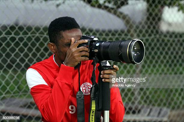 Samuel Eto'o of Antalyaspor takes a photo with a photojournalist's digital camera during a training session in Antalya Turkey on December 9 2015