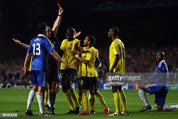 Samuel Eto'o of Barcelona and his team mates argues with referee Tom Henning Ovrebo after Eric Abidal of Barcelona received a red card during the...