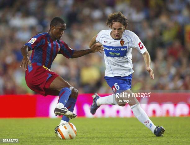 Samuel Eto'o of Barcelona battles with Gabriel Milito of Zaragoza during the La Liga match between FC Barcelona and Real Zaragoza played at the Camp...