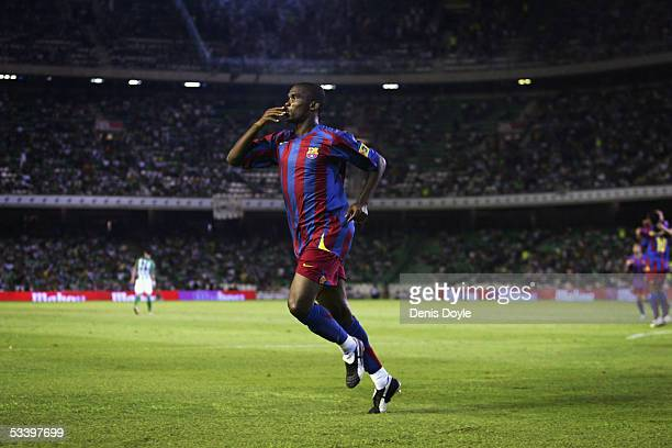 Samuel Eto'o of Barcelona celebrates after scoring a goal during a Supercup first leg match between Real Betis and FC Barcelona at the Ruiz de Lopera...