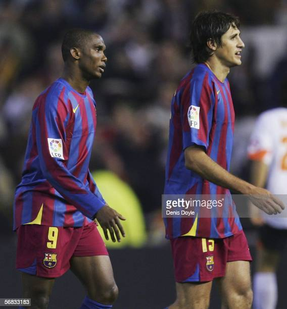 Samuel Eto'o of Barcelona leaves the field with Edmilson after his side lost 10 to Valencia during the Primera Liga match between Valencia and...