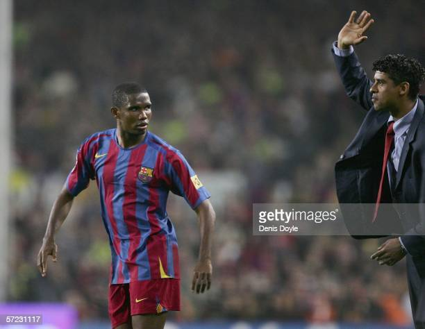 Samuel Eto'o of Barcelona listens to manager Frank Rijkaard during a Primera Liga match between Barcelona and Real Madrid at the Camp Nou stadium on...