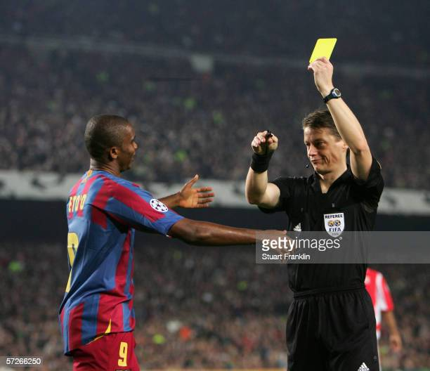 Samuel Eto'o of Barcelona recieves a yellow card from referee Michel Lubos during UEFA Champions League Quarter Final second leg match between...