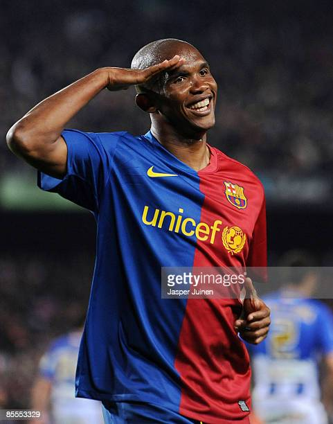 Samuel Eto'o of Barcelona salutes the crowd as he celebrates scoring his side's sixth goal during the La Liga match between Barcelona and Malaga at...