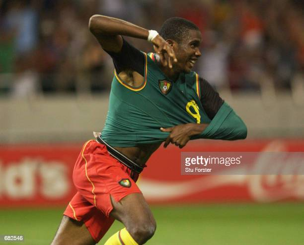 Samuel Eto'o of Cameroon celebrates after scoring the opening goal of the match during the FIFA World Cup Finals 2002 Group E match between Cameroon...