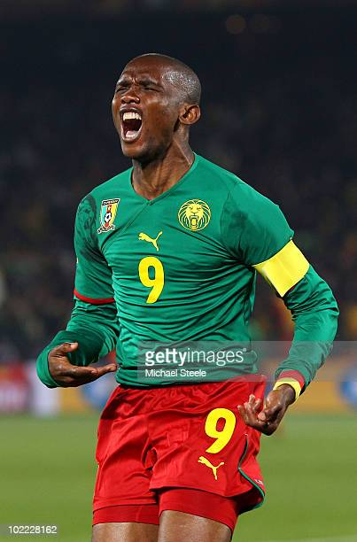 Samuel Eto'o of Cameroon celebrates scoring the first goal during the 2010 FIFA World Cup South Africa Group E match between Cameroon and Denmark at...
