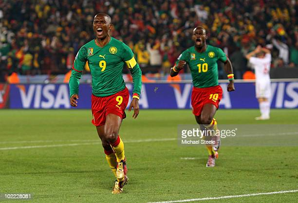 Samuel Eto'o of Cameroon celebrates scoring the first goal with team mate Achille Emana during the 2010 FIFA World Cup South Africa Group E match...
