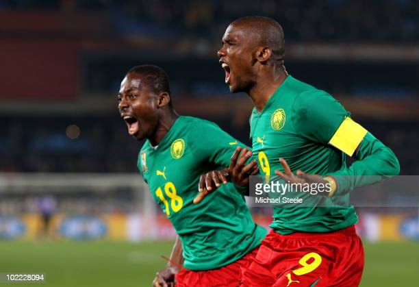 Samuel Eto'o of Cameroon celebrates scoring the first goal with team mate Eyong Enoh during the 2010 FIFA World Cup South Africa Group E match...