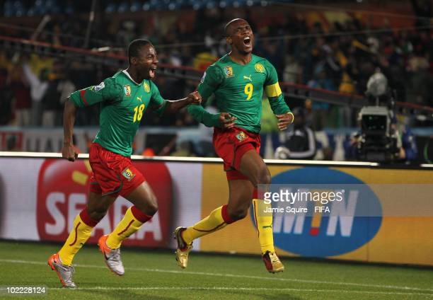 Samuel Eto'o of Cameroon celebrates with team mate Eyong Enoh after scoring the opening goal during the 2010 FIFA World Cup South Africa Group E...