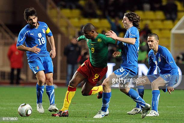 Samuel Eto'o of Cameroon is Challenged by Riccardo Montolivo of Italy as Gennaro Gattuso and Leonardo Bonucci look on during the International...