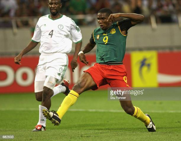 Samuel Eto'o of Cameroon scores the opening goal of the match during the FIFA World Cup Finals 2002 Group E match between Cameroon and Saudi Arabia...