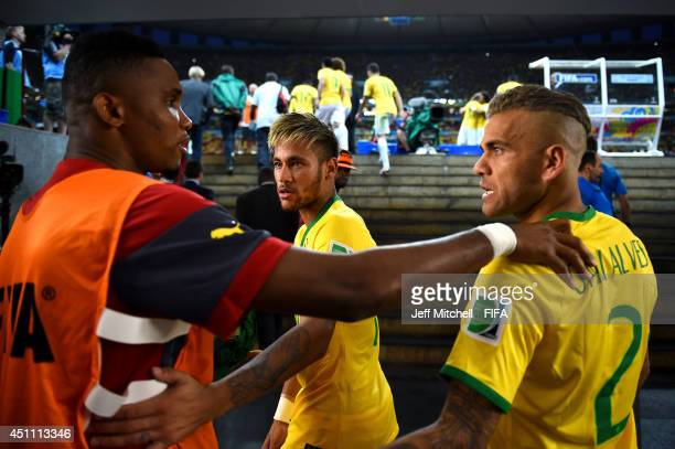 Samuel Eto'o of Cameroon speaks to Neymar and Dani Alves of Brazil during the half time in the tunnel during the 2014 FIFA World Cup Brazil Group A...