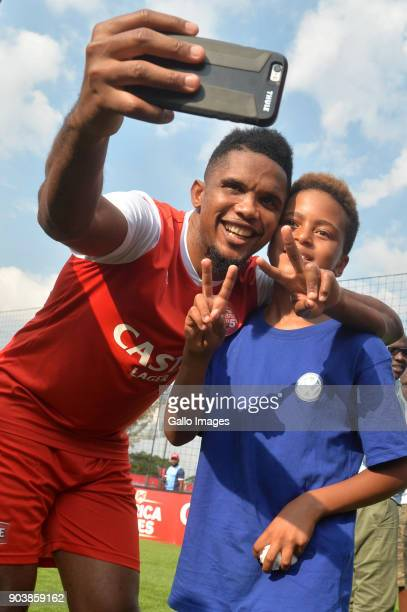 Samuel Eto'o of Cameroon takes a selfie with football legend Mark Haskins son Mikael Haskins during the Castle Africa 5's Media Launch at Dicovery...