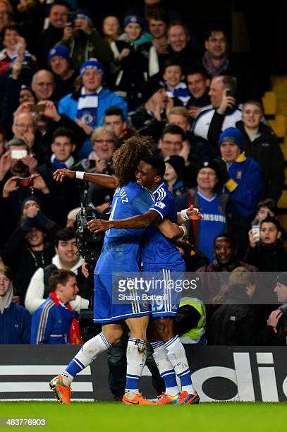 Samuel Eto'o of Chelsea celebrates with teammate David Luiz after scoring his team's second goal during the Barclays Premier League match between...