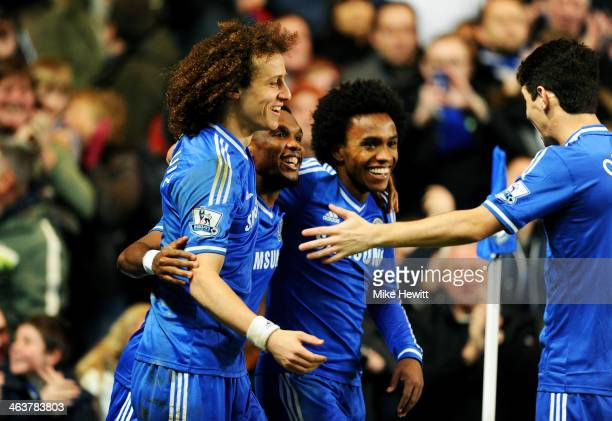 Samuel Eto'o of Chelsea celebrates with teammates David Luiz Willian and Oscar after scoring his team's third goal and completing his hat trick...