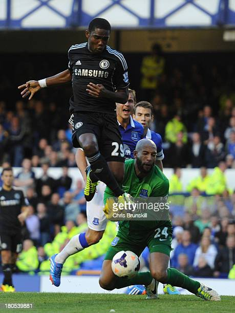 Samuel Eto'o of Chelsea collides with Tim Howard of Everton during the Barclays Premier League match between Everton and Chelsea at Goodison Park on...