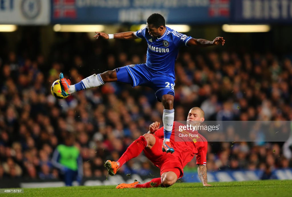 Samuel Eto'o of Chelsea controls the ball under pressure from Martin Skrtel of Liverpool during the Barclays Premier League match between Chelsea and Liverpool at Stamford Bridge on December 29, 2013 in London, England.
