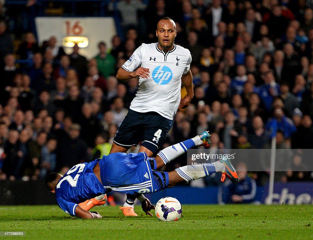 Samuel Eto'o of Chelsea is brought down by Younes Kaboul of Spurs during the Barclays Premier League match between Chelsea and Tottenham Hotspur at Stamford Bridge on March 8, 2014 in London, England. Kaboul was later shown the red card for this challenge by referee Michael Oliver and also conceded a penalty.