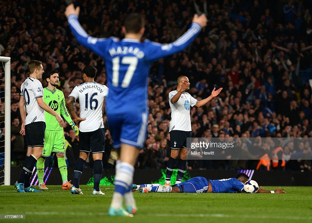 Samuel Eto'o of Chelsea is brought down by Younes Kaboul (2nd R) of Spurs during the Barclays Premier League match between Chelsea and Tottenham Hotspur at Stamford Bridge on March 8, 2014 in London, England. Kaboul was later shown the red card for this challenge by referee Michael Oliver and also conceded a penalty.