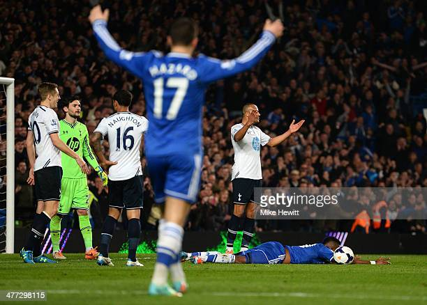 Samuel Eto'o of Chelsea is brought down by Younes Kaboul of Spurs during the Barclays Premier League match between Chelsea and Tottenham Hotspur at...
