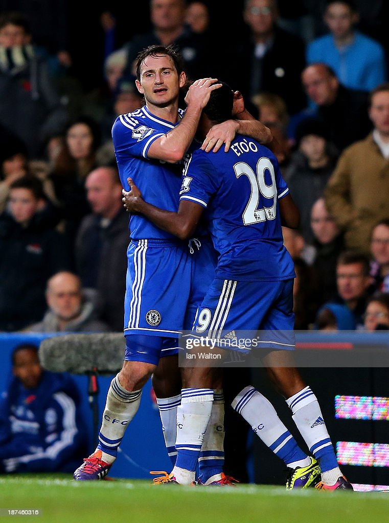 Samuel Eto'o (R) of Chelsea is congratulated by teammate Frank Lampard after scoring the opening goal during the Barclays Premier League match between Chelsea and West Bromwich Albion at Stamford Bridge on November 9, 2013 in London, England.