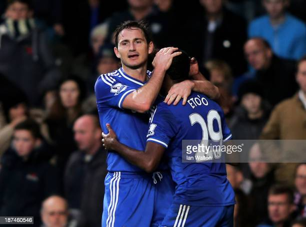 Samuel Eto'o of Chelsea is congratulated by teammate Frank Lampard after scoring the opening goal during the Barclays Premier League match between...