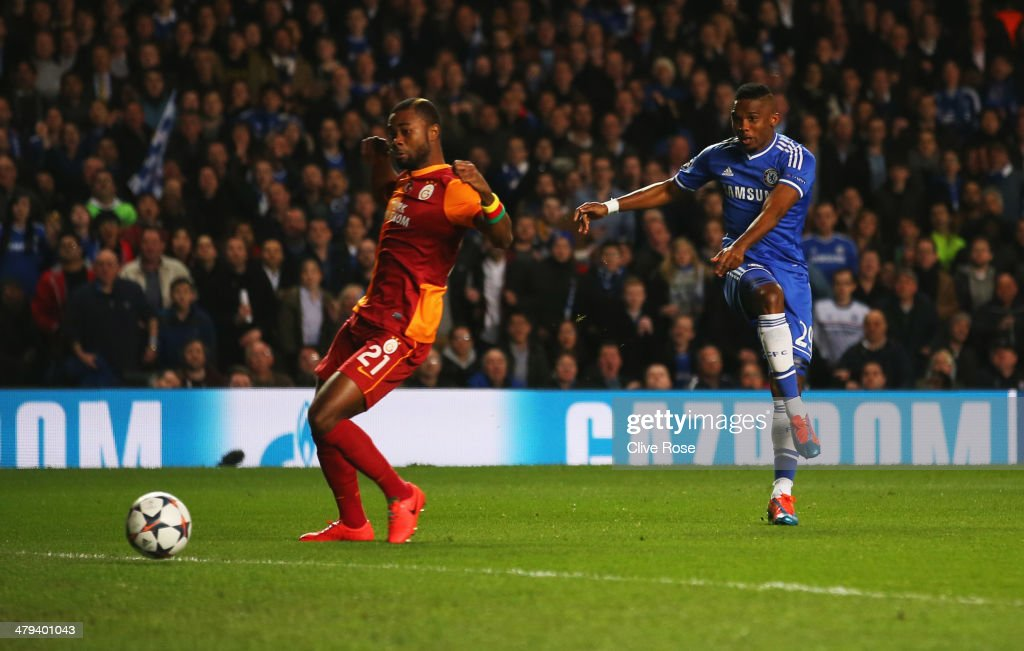 Samuel Eto'o of Chelsea shoots past Aurelien Chedjou of Galatasaray to score their first goal during the UEFA Champions League Round of 16 second leg match between Chelsea and Galatasaray AS at Stamford Bridge on March 18, 2014 in London, England.