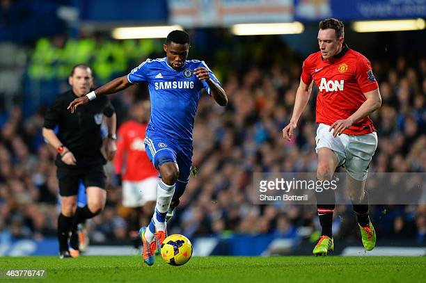 Samuel Eto'o of Chelsea takes on Phil Jones of manchester United prior to scoring the opening goal during the Barclays Premier League match between...