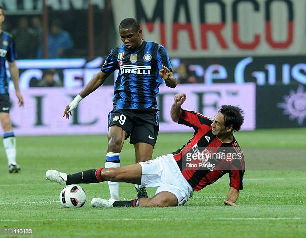 Samuel Eto'o of FC Inter competes with Alessandro Nesta of AC Milan during the Serie A match between AC Milan and FC Internazionale Milano at Stadio...