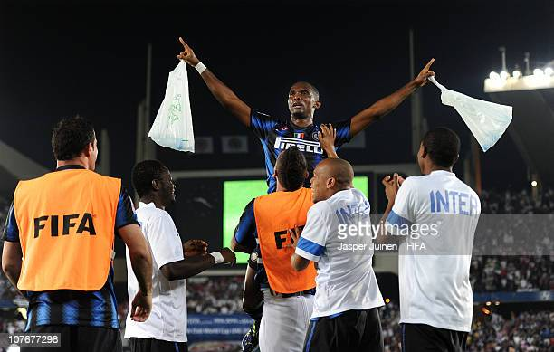 Samuel Etoo of FC Internazionale Milano celebrates scoring his side second goal on the shoulders of his teammates during the FIFA Club World Cup...