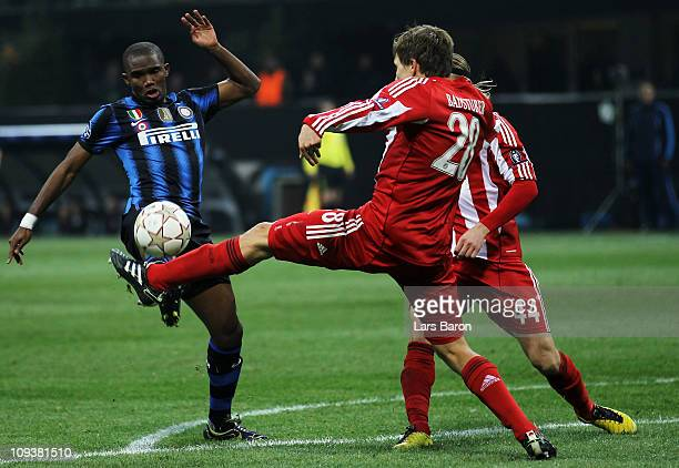 Samuel Eto'o of Inter is challenged by Holger Badstuber of Muenchen during the UEFA Champions League round of 16 first leg match between Inter Milan...