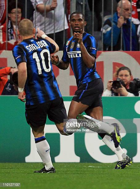 Samuel Eto'o of Inter Milan celebrates his first goal with his teammate Wesley Sneijder during the UEFA Champions League round of 16 second leg match...